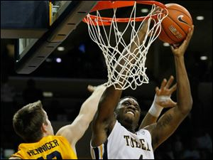 UT's Justin Drummond dunks and is fouled by Kent State's Mark Henniger with 63 seconds to play.