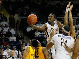 The Rockets' Justin Drummond rises above Kent State's Darren Goodson.