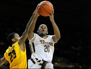 Toledo's Julius Brown drives against Kent State's Derek Jackson.