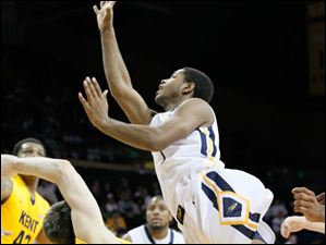 Toledo's Jonathan Williams is fouled by KSU's Mark Henniger in the first half.