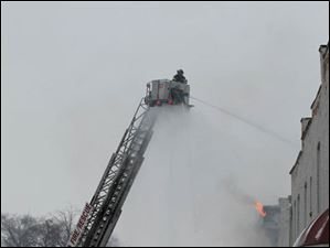Toledo firefighters battle a blaze at 528 Magnolia, a six-unit apartment building in Toledo.