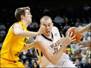 The Rockets' Zach Garber drives past Kent State's Mark Henniger.
