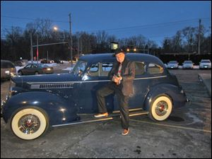 Tom Schwann poses in front of the Packard.