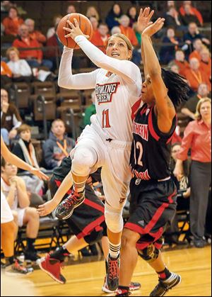 Bowling Green's Jillian Halfhill drives to the basket to take a shot while being defended by Northern Illinois' Danny Pulliam.