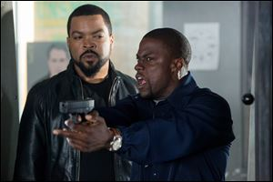 Ice Cube, left, and Kevin Hart in a scene from 'Ride Along.'