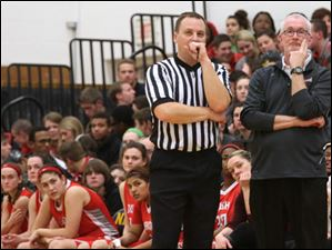 Central Catholic's head coach Marty McGurk, right, talks with a referee in the third quarter.