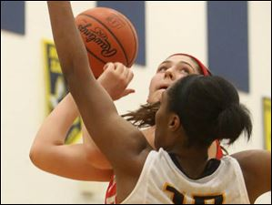 Central Catholic's junior Mikayla Simon (50) goes in for a layup under pressure from Notre Dame's junior Kaayla McIntyre (15) in the third quarter.