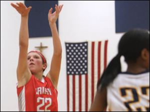 Central Catholic's  sophomore Byrdy Galernik (22) puts up two points in the third quarter.