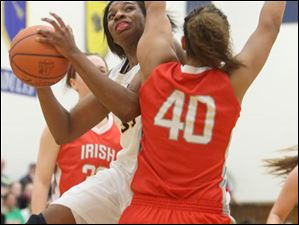 Notre Dame's Tierra Floyd (31) drives in for a layup against Central Catholic's junior Demi Russell (40) in the second quarter.