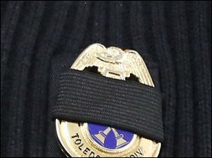 A mourning band over the badge of a Toledo Fire Department battalion chief.