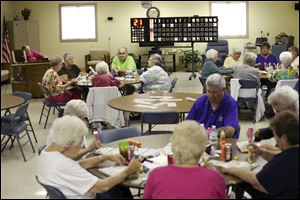 Dozens play bingo at the Oregon Senior Center. Programs helping seniors understand benefits, manage health problems, and get more exercise are under consideration with new levy funds.