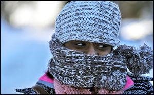 Nyjaii Williams, of St. Paul, is bundled up against the cold wind, Sunday in St. Paul, Minn.