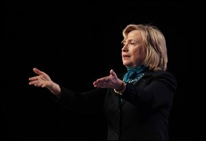 Former Secretary of State Hillary Rodham Clinton speaks to the National Automobile Dealers Association meeting Monday in New Orleans.