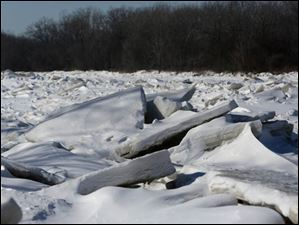 Ice blocks jut up from the Maumee River close to the bank near Fort Meigs in Perrysburg.