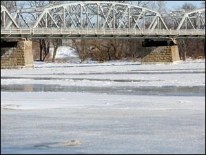 The ice and snow are starting to melt on the Maumee River in Waterville.