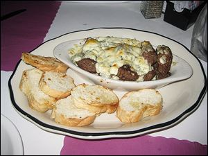 Beef tips with melted blue cheese and toasted bread rounds BJ's Hide-A-Way  in Oregon.