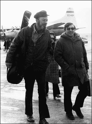 This Feb. 10, 1971, file photo shows American Folk singer Pete Seeger, left, with Spanish singer Raymond, at Madrid's Barajas airport enroute to a concert in the southern Spanish city of Seville.