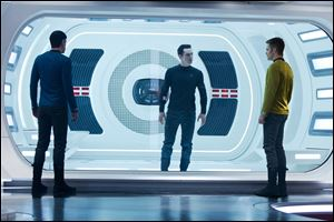 Zachary Quinto, as Spock, Benedict Cumberbatch as John Harrison, and Chris Pine as Kirk, in a scene in the movie,