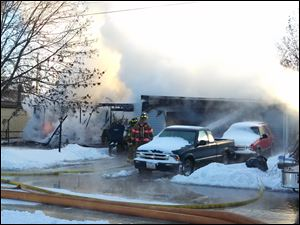 Northwood fire crews battle a blaze in the 900 block of Gould Street early today.