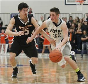 Lake's Connor Bowen drives past Otsego's Jerome Griffin. The 6-foot junior leads the team in scoring (19.8) and assists (9.1), and averages 5.5 rebounds. The Flyers are 13-0 overall, 7-0 in the Northern Buckeye Conference.