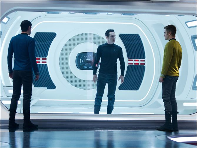 Film Review-Star Trek Into Darkness Zachary Quinto, as Spock, Benedict Cumberbatch as John Harrison, and Chris Pine as Kirk, in a scene in the movie,