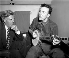 Henry-A-Wallace-listens-to-Pete-Seeger-on-a-plane