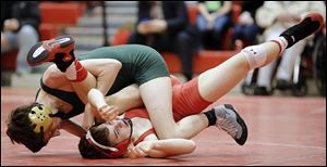 Clay's Evan True pinned Elyria's Brandon Lang in 2 minutes, 41 seconds in a 113-pound match.