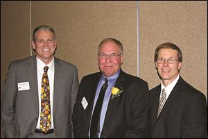 Tom Hosler, Richard Schnitkker, and Ray Pohlman.