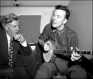 Henry A. Wallace,listens to Pete Seeger  on a plane between Norfolk and Richmond, Va., in 1948.