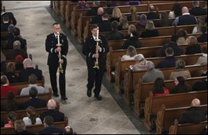 Firefighters celebrate mass and the lives of Toledo firefighters Stephen A. Machcinski and James Dickman at the Historic Church of St. Patrick in Toledo.