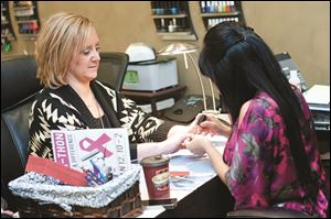 Sarah Helm and Seng Brown, nail technician.