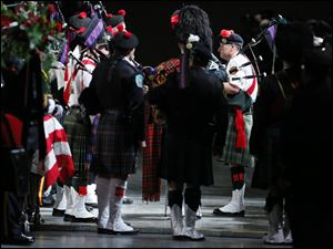 Bag pipers play during the Last Alarm funeral service.