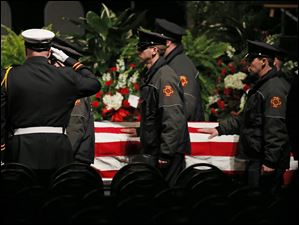 The casket of Toledo firefighter Stephen A. Machcinski is carried into the SeaGate Convention Centre.
