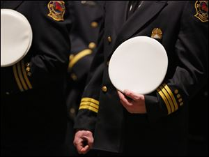 Members of the Cleveland Fire Department stand during the Last Alarm funeral service.