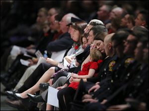 Members of the Dickman and Machcinski familes listen during the Last Alarm funeral service.