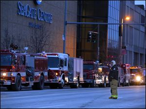 Springfield Fire Captain Mike Kokocinski directs traffic outside of the Seagate Convention Centre.