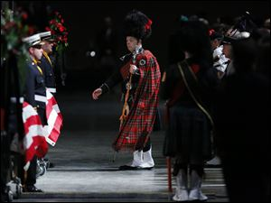 Bagpipers and drummers are led in to  the Last Alarm memorial service at SeaGate Convention Centre for Toled