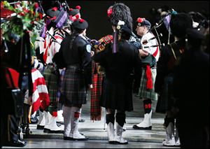Bagpipers, who played a central role throughout the service for Stephen Machcinski and James Dickman, perform. STORY, PHOTOS ON PAGE A6.