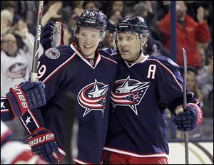 Columbus' Ryan Johansen, left, and Jack Johnson celebrate Johansen's goal against the Washington Capitals during the second period.