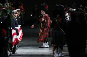 Bagpipers and drummers are led in to  the Last Alarm memorial service at SeaGate Convention Centre for Toledo firefighters Stephen Machcinski and James Dickman.