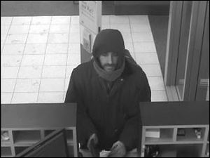 Surveillance footage of the bank robbery in Point Place.