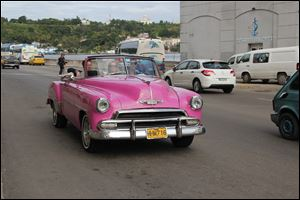 Many old cars still fill the streets in Cuba.