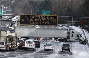 A truck blocks all east-bound lanes of   Interstate 285 in Sandy Spring, Ga. after hitting a patch of ice.