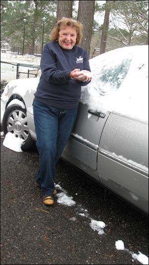 Mary Alice Powell and her snow-covered car in South Carolina. The storm caused chaos in parts of the South last week.