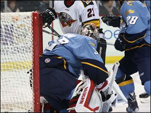Toledo's goalie Jared Coreau (33) can't stop the puck against Cincinnati during the second period.