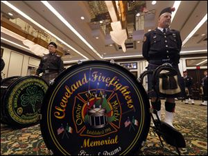 Fred Kartune with the Cleveland Firefighters Memorial Pipes & Drums waits with other national members of the pipes and drum corps before playing at the Last Alarm Service at the SeaGate Convention Centre downtown for firefighters Stephen Machcinski and James Dickman, who were killed in the line of duty Sunday in Toledo.