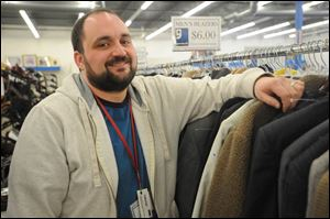 Tyler Gedelian, manager of the Monroe Goodwill store.