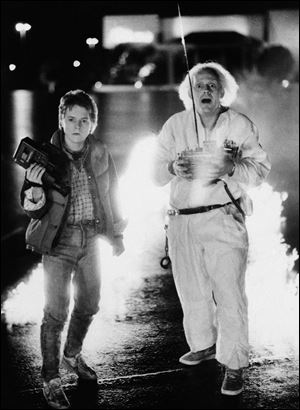 "Michael J. Fox as Marty McFly, left, and Christopher Lloyd as inventor Doctor Emmett Brown in a scene from the film, ""Back to the Future."""