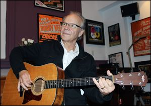 Bobby Vee plays the guitar at his family's Rockhouse Productions in St. Joseph, Minn. Alzheimer's disease forced the 1960s pop idol to stop performing in 2011.