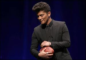 Bruno Mars will headline the halftime show at Super Bowl XLVIII on Sunday.